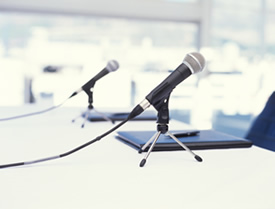 two microphones on a table close up